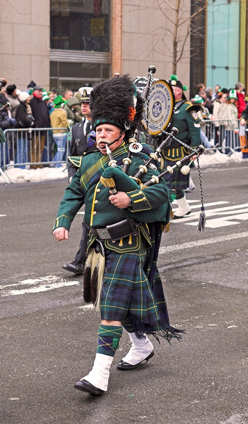 bagpippers walking in st. patrick's day parade
